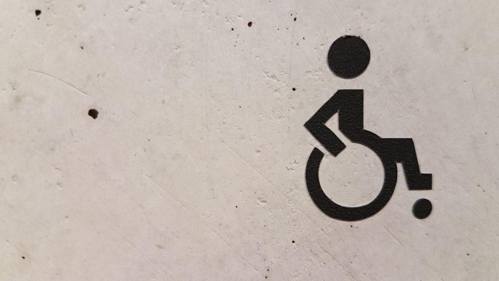 Icon von einem Rollstuhlfahrer